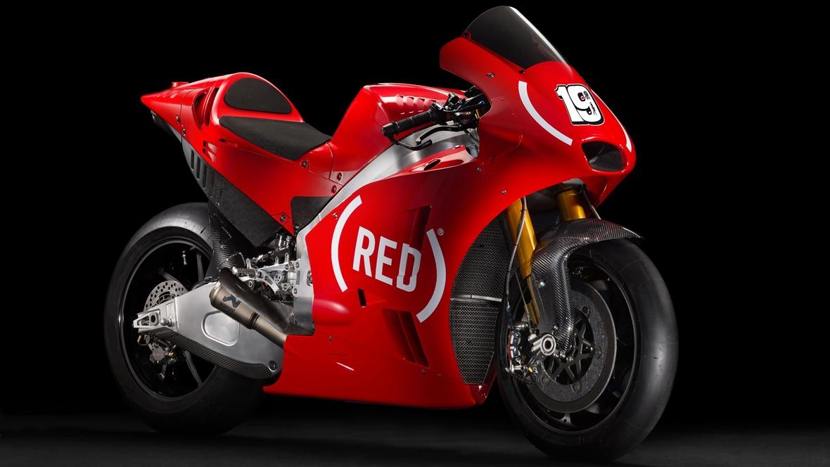 Las Aprilia de MotoGP correrán de rojo en Cheste para luchar contra el SIDA